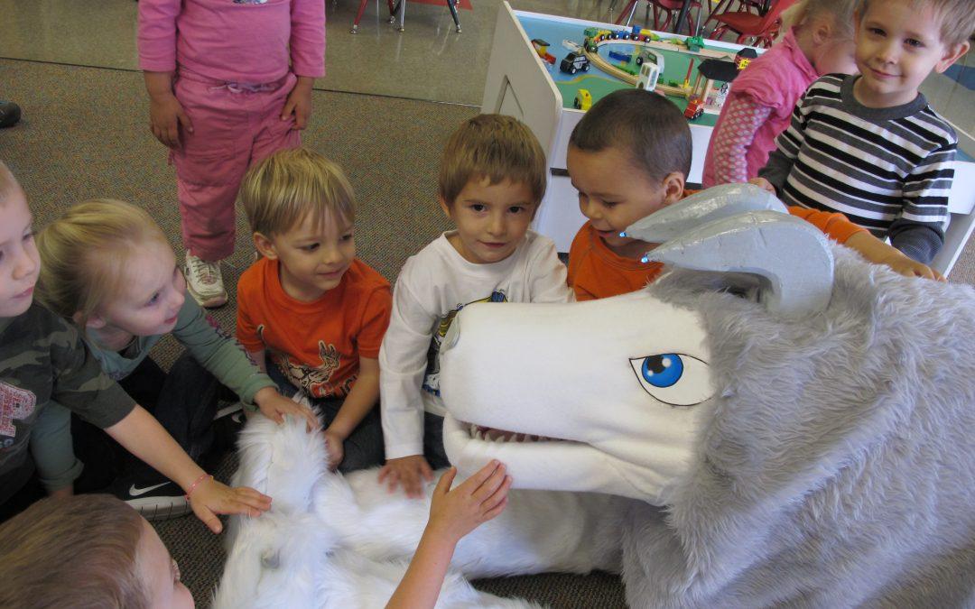 students petting a big stuffed dog